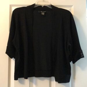 Black short cardigan with button accent on sleeves